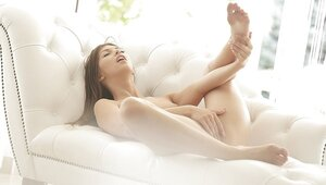 Gal becomes excited so her morning starts with self-satisfaction on couch