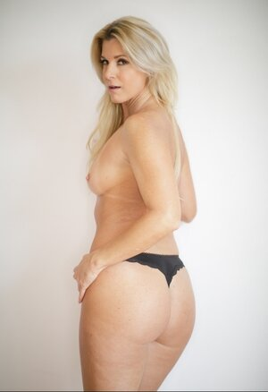 Blonde Sexually available mom with small chest poses naked at every opportunity to gladden guys