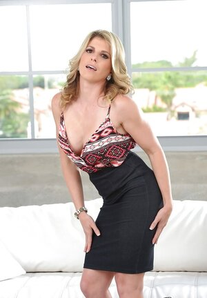 Blonde cougar shows round bra buddies and also takes off all her office clothes