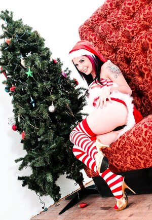 Modern Snow Maiden is tattooed and plus masturbates both holes with cand plusies