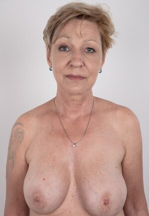 Old porn star with tattooed shoulder advertises natural twins and slit