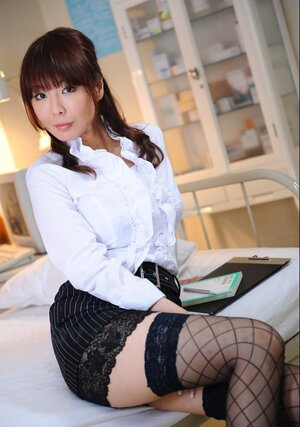 Oriental office enjoy in stockings opens blouse showing off her tender breasts