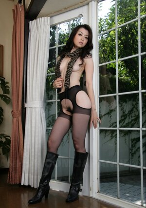 Exotic performer poses in sexy black pantyhose that expose her shaggy snatch
