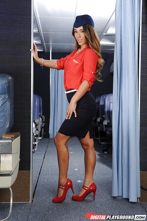 Business class stewardess Eva Lovia takes off sexy uniform in the plane