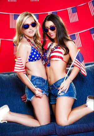 Patriotic young and fresh girlfriends take off sexy shorts and embark licking peaches