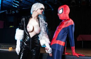 Spider-man bangs platinum blonde villain in latex showing why he is a superhero