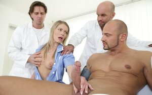 Muscled patient has a boner cause of hot nurse and besides she deals with it