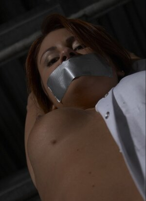 More experienced lad takes the duct tape off girl's mouth to give her cock for giving head